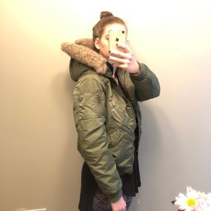 Green jacket with faux fur hood